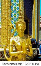 Golden Kinnari statue in Temple of Emerald Buddha (Wat Phra Kaew) in Bangkok,Thailand