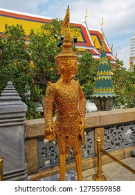 Golden Kinnari statue at Temple of Emerald Buddha The Grand Palace Thailand And Wat Phra Kaew