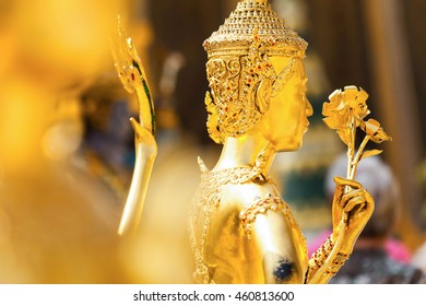 Golden Kinnari statue at Temple of Emerald Buddha (Wat Phra Kaew)