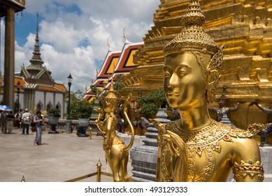 Golden Kinnari statue at Temple of Emerald Buddha (Wat Phra Kaew) in Grand Royal Palace.Bangkok, Thailand
