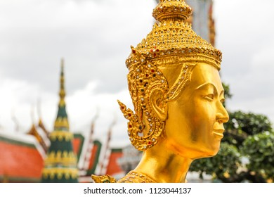Golden Kinnari statue  at Wat Phra Kaew ,The Temple of Emerald Buddha in Bangkok, Thailand