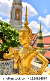 Golden Kinnari statue at Wat Phra Kaew ,The Temple of Emerald Buddha in Bangkok, Thailand.