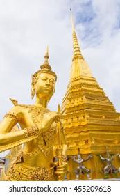Golden Kinnari statue at Wat Phra Kaew (Temple of Emerald Buddha) in Grand Royal Palace. Kinnari is Half-bird - half-woman creature at south-east Asian Buddhist mythology. Bangkok, Thailand
