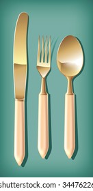 Golden knife, fork and spoon.