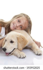 golden labrador dog with young girl