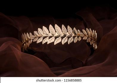 golden laurel wreath headband isolated on the fabric