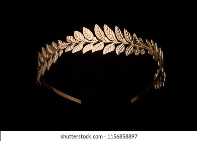 golden laurel wreath headband isolated on black