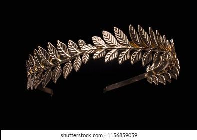 golden laurel wreath headband isolated on black