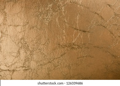 Golden leather background close-up