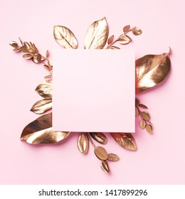 Golden leaves on pink background with copy space. Top view. Copy space. Summer and autumn concept. Creative design elements for invitation, wedding cards, valentines day, greeting cards.