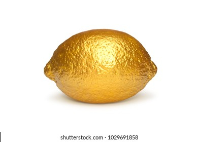 Golden lemon isolated on white background. Creative concept with fruit.