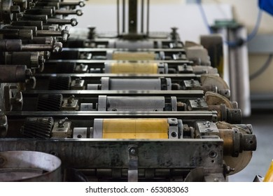 Golden Letterpress Cylinders Rustic Vintage Printing Method Metallic Rollers Four Color CMYK Print Closeup Machine Industrial Equipment