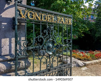 Golden letters of VONDELPARK on the main entrance gate into the park, The Vondelpark is a public urban park of 47 hectares (120 acres) in Amsterdam, Netherlands.