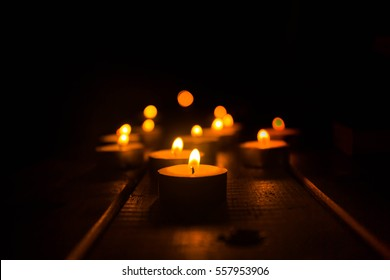 Golden light of candle flame.