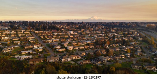 Golden light hits the homes here on clear afternoons at sunset in Tacoma