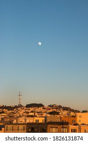 Golden light and the moon over the Sunset District in San Francisco, California