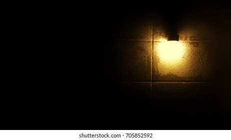 Golden light on the wall background. The light can help you to see in the dark