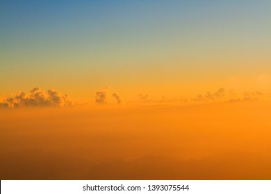 Golden light with sunrise in morning on the sky and clound .Fog cover the jungle hill in Thailand