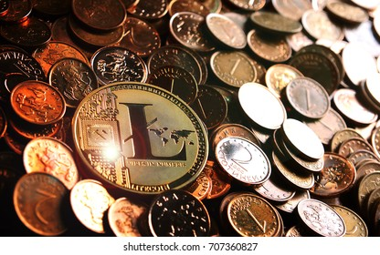 Golden  Litecoin crypto currency on heap of golden coins