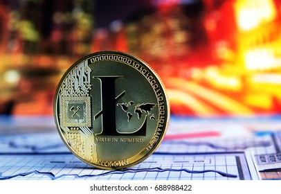 golden litecoin on colorful background