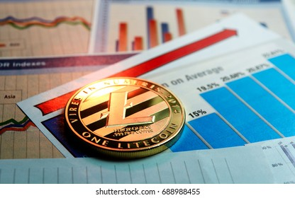 A golden litecoin on graph and diagrams background. concept of trading crypto currency