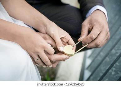 golden lock in young couples hands