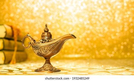 golden magic aladdin's lamp on bright and blur background