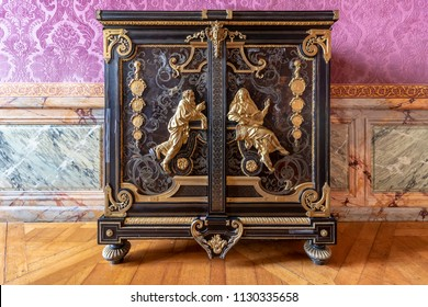 Golden and mahogany furniture in  the Royal Palace of Versailles in France