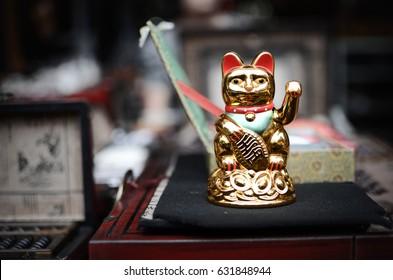 Golden Maneki Neko cat or Welcome mascot. Common Japanese sculpture bring good luck to the owner.