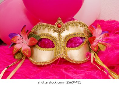 golden mask with flowers and pink fluffy fur and balloons