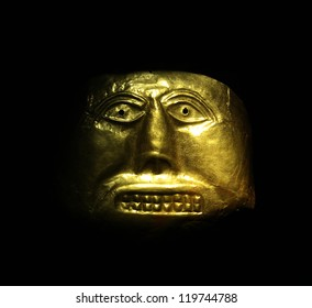 Golden mask in the Gold Museum, Bogota, Colombia. Tolima culture, Pre-Columbian America