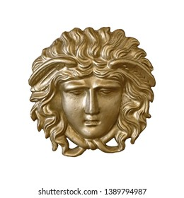 Golden mask of the Greek goddess in the old palace interior. Design element with clipping path