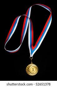 Golden medal isolated on black