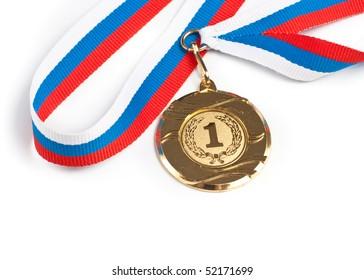 Golden medal isolated on white