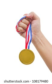 Golden medal in man's hand isolated on white background.