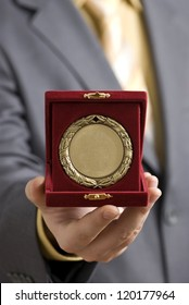 Golden medal offered as a symbol of success.