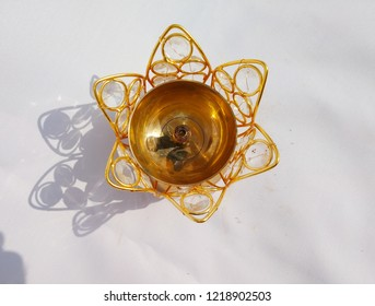 golden metal and crystal deepak or diya that is used in performing prayer to the god, lit the lamp and see the beauty