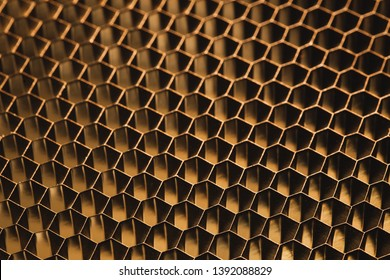 golden metallic honeycomb grid texture pattern background
