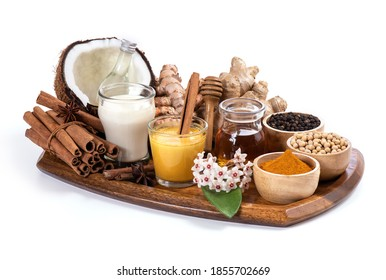 Golden milk with Soybean milk,turmeric,cinnamon,ginger ,black pepper,honey and coconut oil for healthy drink isolated on white background.