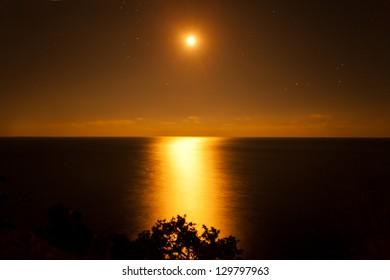 golden moon over the sea