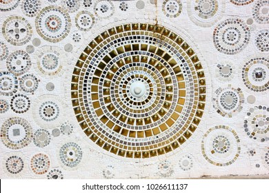 the golden mosaic in the circle pattren with colorful mosaic on white background