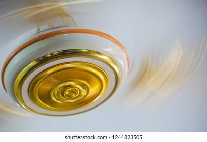 Golden moving ceiling fan isolated unique photo