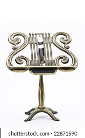 a golden music stand with a customizable label