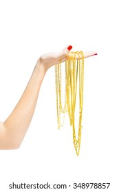 golden necklace in hand isolated with clipping path.