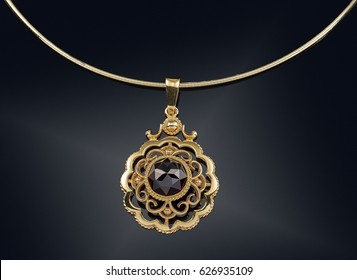 Golden necklace with isolated on black background.