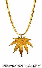Golden necklace in shape of marijuana leaf on gold chain isolated on white background