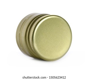 Golden new metal twist bottle cap isolated on white, side view, macro