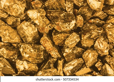 Golden nuggets closeup. Background textured