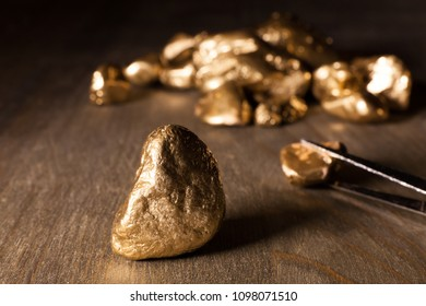 golden nuggets on wooden table