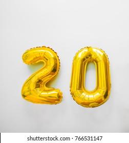 Golden number 20 twenty golden metallic balloon. Party decoration golden balloons. Anniversary sign for happy holiday, celebration, birthday, carnival, new year. Metallic design balloon